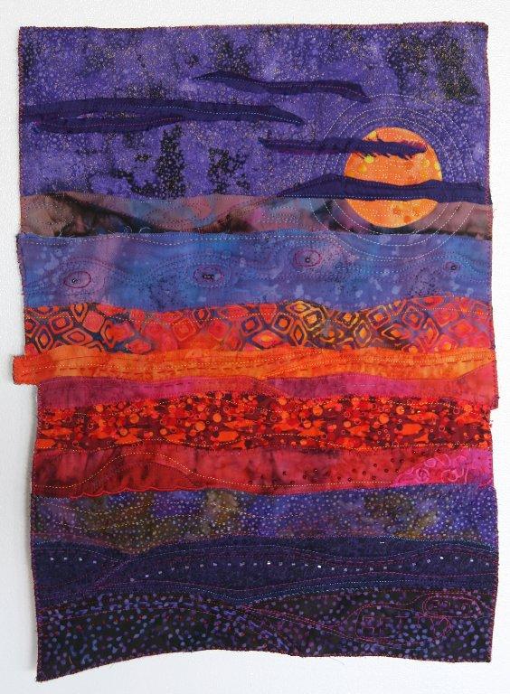 Tapiz de patchwork art quilt violeta naranja
