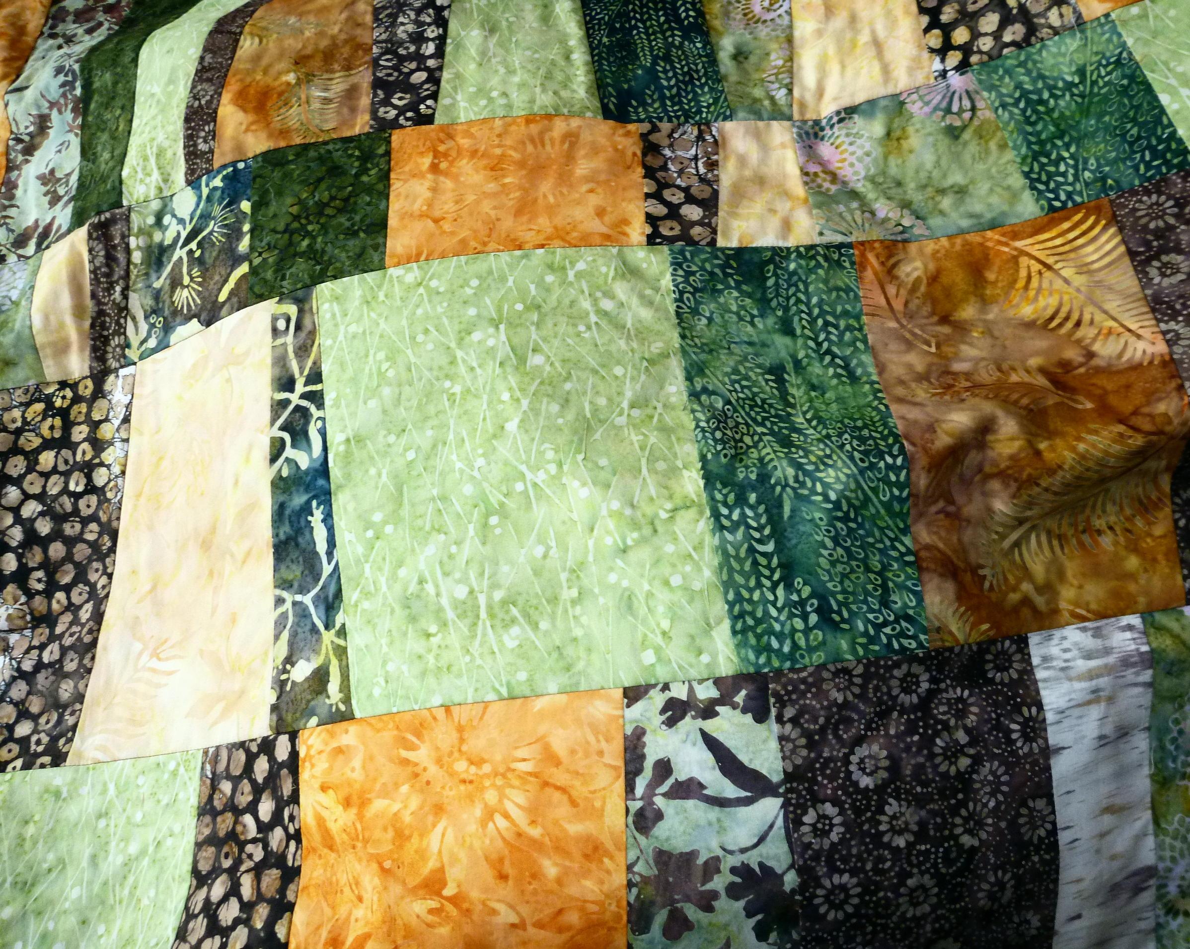 Detalle del quilt de patchwork de batiks.