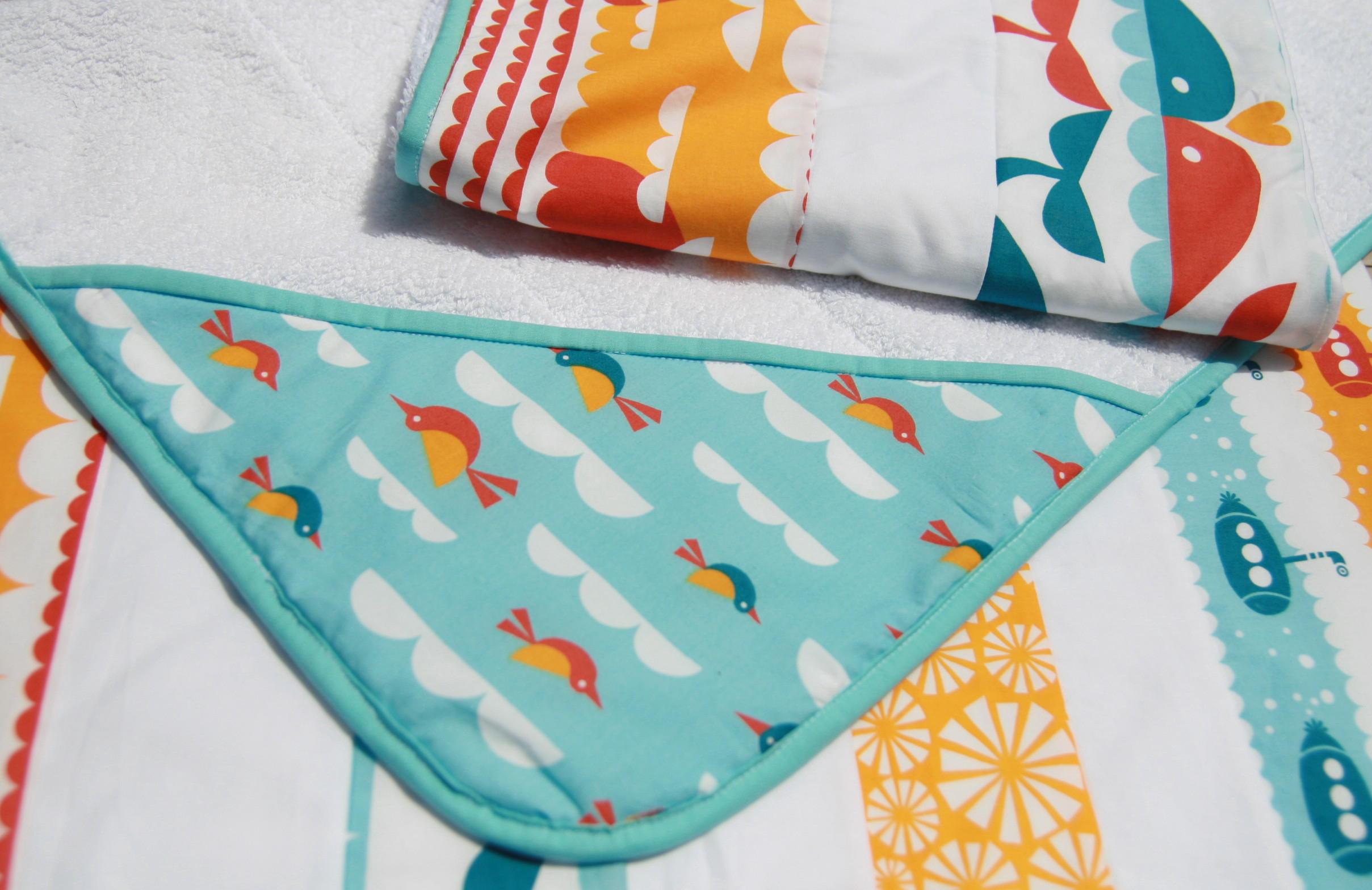 Arrullos de patchwork para bebé con capucha