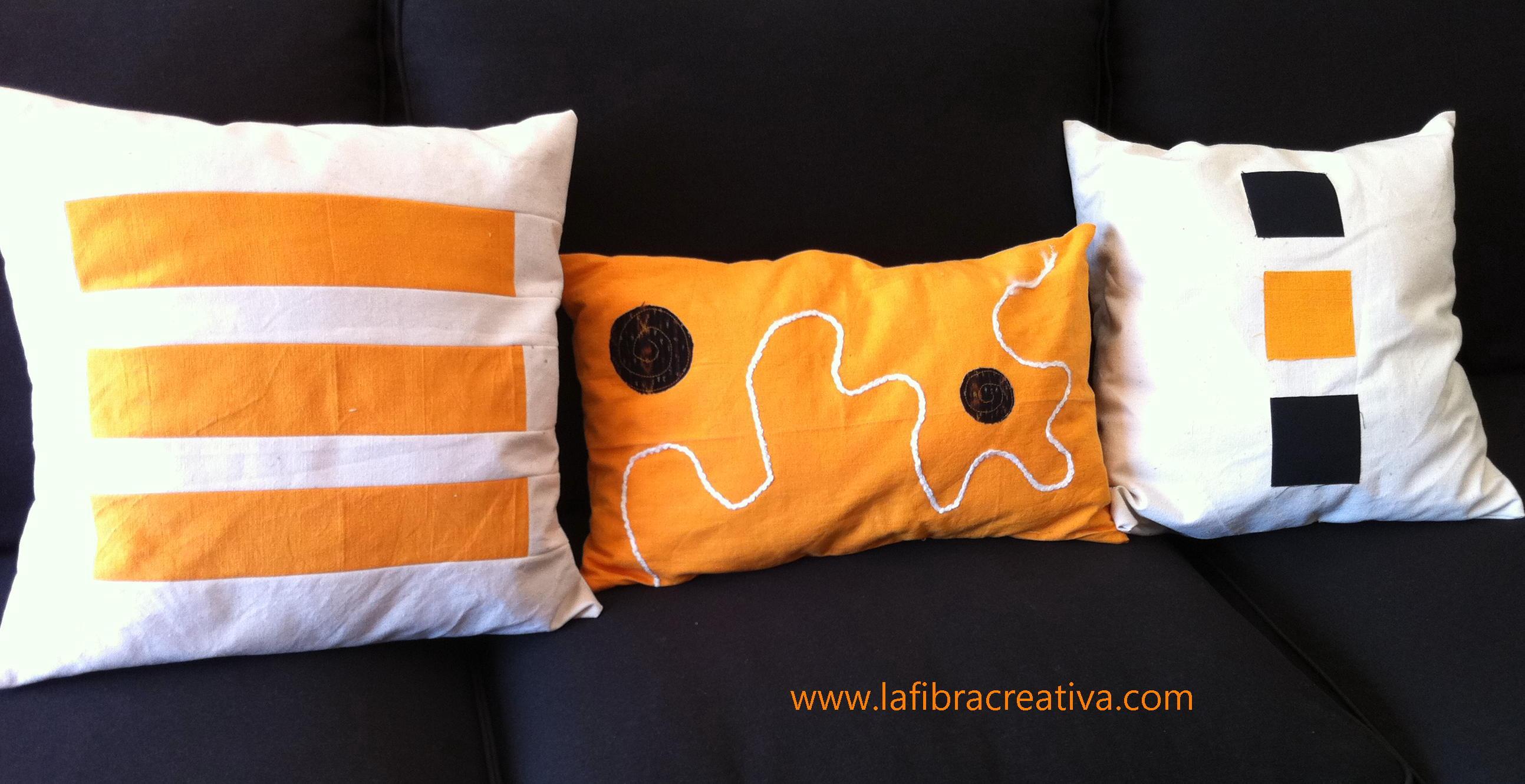 Cojines patchwork moderno en blanco, naranja y negro