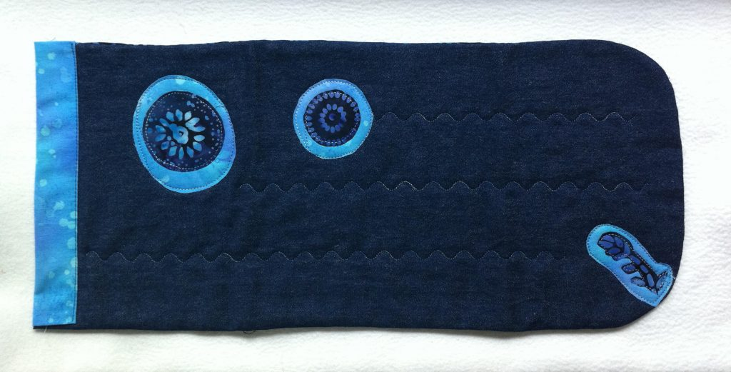 base bolso tejano con aplicaciones de batik