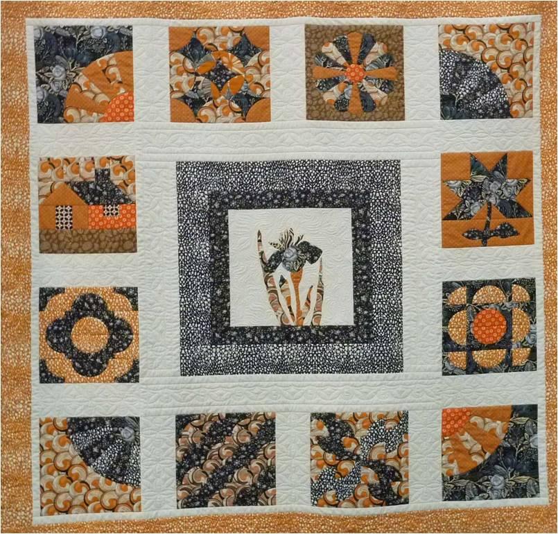 sampler quilt acolcado con brazo largo